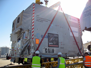 The Gaia satellite being prepared for shipment to Kourou. The 10 tonne container is placed with a huge crane onto the access ramp before loading into the Antonov airplane. © Isabelle Desenclos